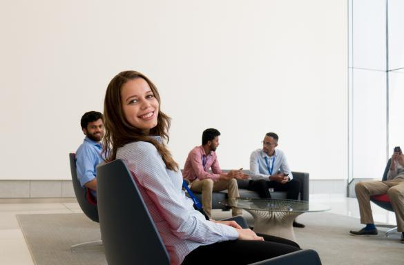 Intern sitting in chair smiling for photo