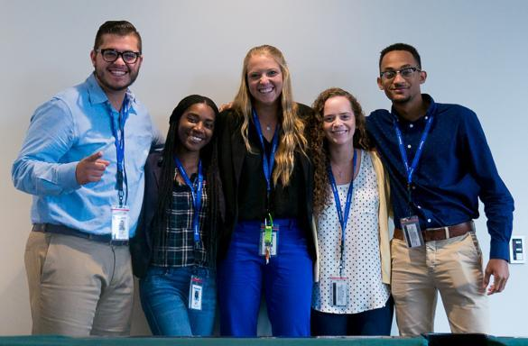Group of interns smiling for photo