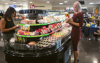 Shoppers select fresh items from Hussmann case