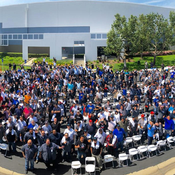 A large group of Chino, California employees pose for a time photo